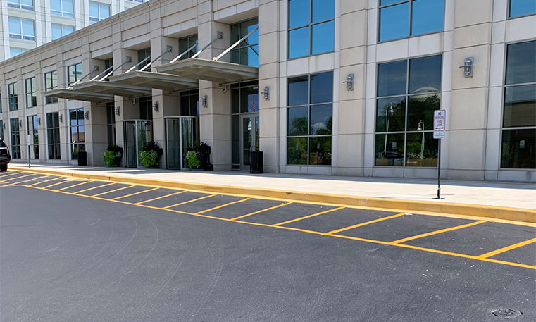 new asphalt and lot markers in hotel parking lot
