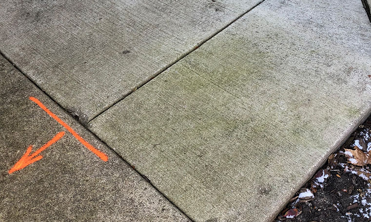 level concrete sidewalk surface