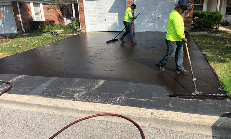 twin bros. paving team sealcoating home driveway