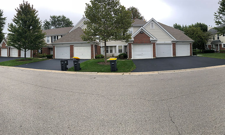 front view of home and driveway with sealcoating