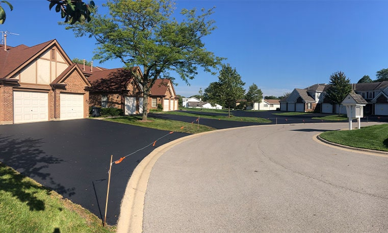 side view of home driveway after sealcoating project
