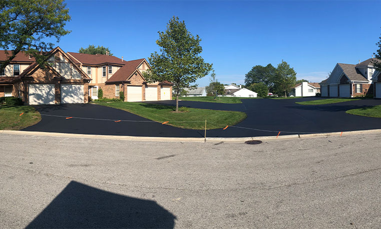 street view of sealcoated home driveway