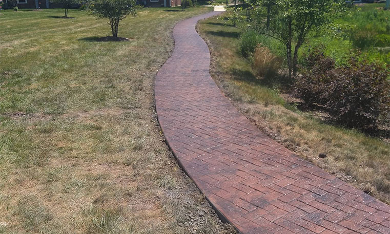 paved walkway outside of condo buildings